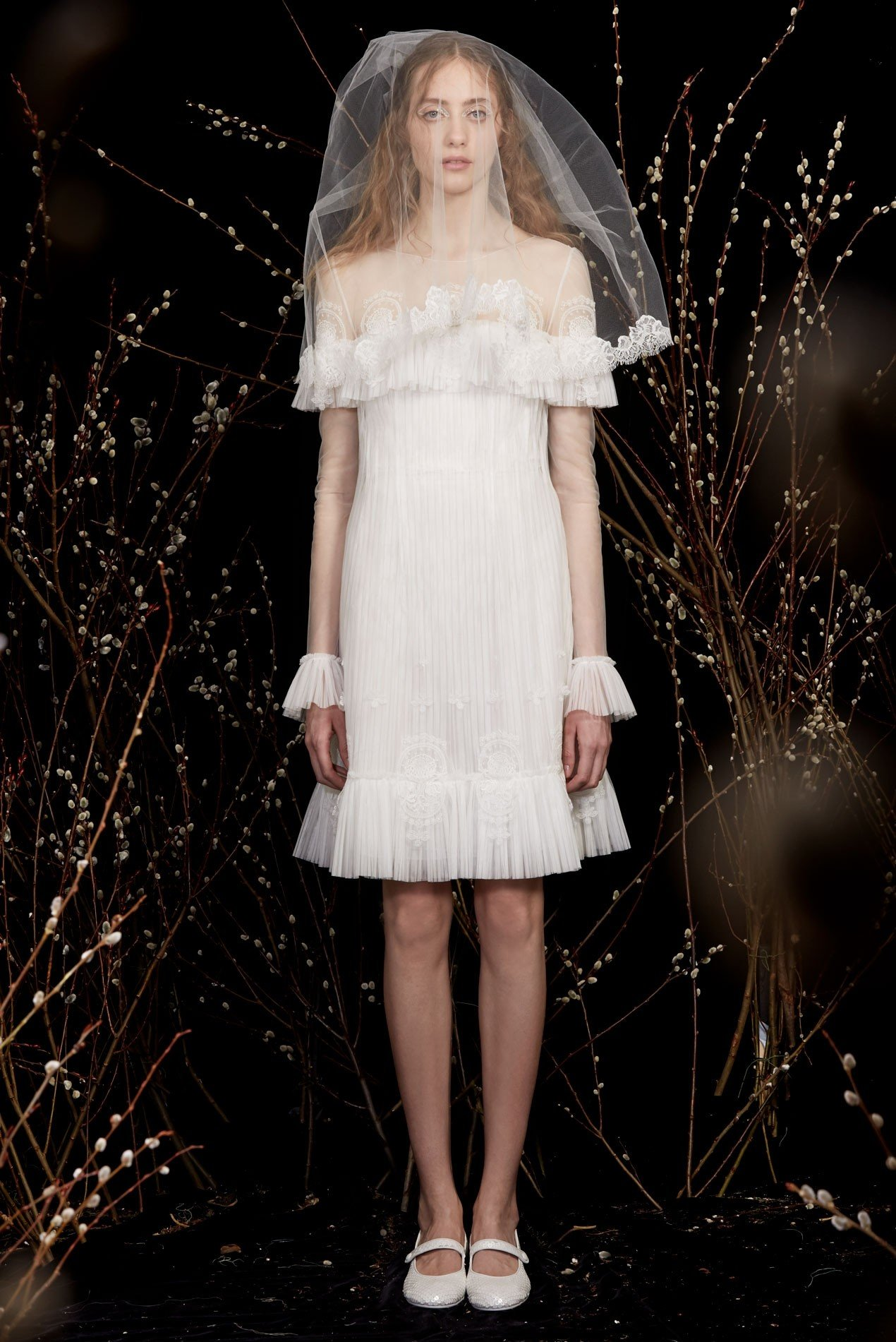 pleated tulle dress with long sleeves and medallion embroidery